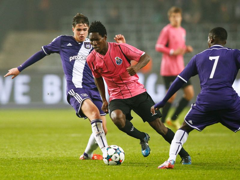 Samy Bourard and Franck Mikal of Anderlecht try to stop Lumor Agbenyenu of Porto during the UEFA Youth League quarter final match between RSC Anderlecht and FC Porto at Constant Vanden Stock Stadium on March 18, 2015 in Brussels, Belgium. (Photo by Dean Mouhtaropoulos/Getty Images for UEFA)