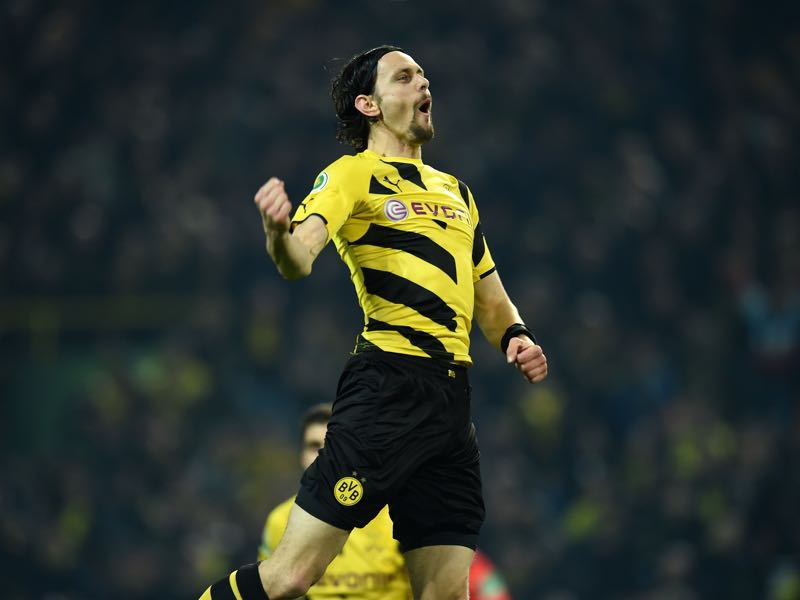 Neven Subotić of Dortmund celebrates with his team-mates after scoring his team's first goal during during the DFB Cup Quarter Final match between Borussia Dortmund and 1899 Hoffenheim at Signal Iduna Park on April 7, 2015 in Dortmund, Germany. (Photo by Matthias Hangst/Bongarts/Getty Images)