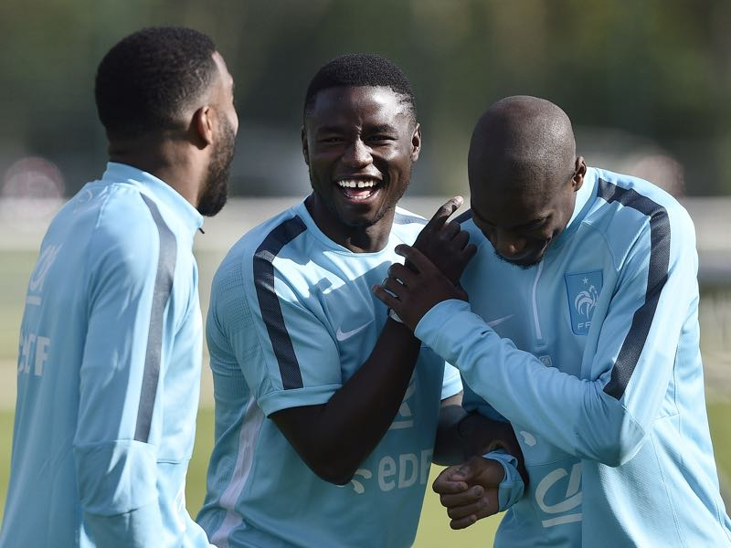 French forward Paul Georges Ntep (C) jokes with French forward Alexandre Lacazette (L) and French midfielder Geoffrey Kondogbia before a training session in Clairefontaine-en-Yvelines, southwestern Paris on June 1, 2015 on the first day of their training ahead of the friendly football match against Belgium to be held on June 07. AFP PHOTO / FRANCK FIFE (Photo credit should read FRANCK FIFE/AFP/Getty Images)