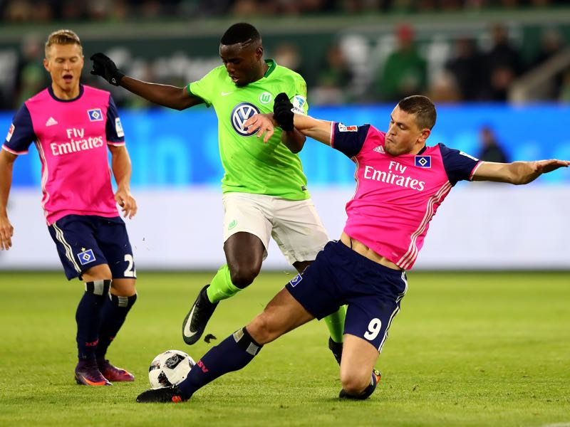 Paul Georges Ntep (L) of Wolfsburg and Kyriakos Papadoulos of Hamburg battle for the ball during the Bundesliga match between VfL Wolfsburg and Hamburger SV at Volkswagen Arena on January 21, 2017 in Wolfsburg, Germany. (Photo by Martin Rose/Bongarts/Getty Images)