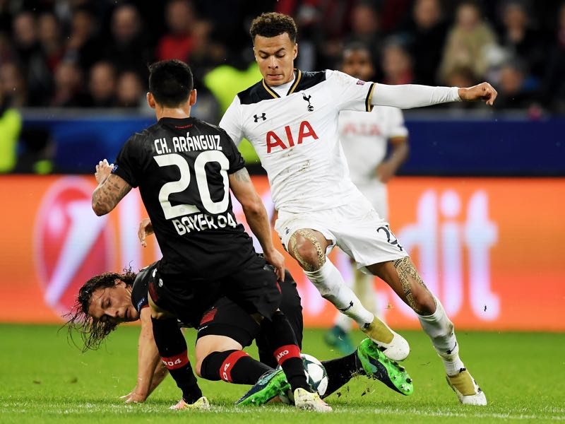 Julian Baumgartlinger (L) of Leverkusen and Dele Alli of Tottenham battle for the ball during the UEFA Champions League group E match between Bayer 04 Leverkusen and Tottenham Hotspur FC at BayArena on October 18, 2016 in Leverkusen, North Rhine-Westphalia. (Photo by Matthias Hangst/Bongarts/Getty Images)