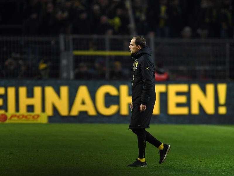 Dortmund's head coach Thomas Tuchel reacts after the German First division Bundesliga football match between Borussia Dortmund and FC Augsburg, in Dortmund, western Germany, on December 20, 2016. / AFP / PATRIK STOLLARZ / RESTRICTIONS: DURING MATCH TIME: DFL RULES TO LIMIT THE ONLINE USAGE TO 15 PICTURES PER MATCH AND FORBID IMAGE SEQUENCES TO SIMULATE VIDEO. == RESTRICTED TO EDITORIAL USE == FOR FURTHER QUERIES PLEASE CONTACT DFL DIRECTLY AT + 49 69 650050 (Photo credit should read PATRIK STOLLARZ/AFP/Getty Images)