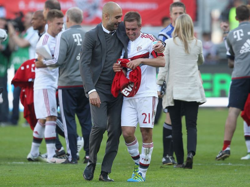 Team coach Josep Guardiola (L) and Philipp Lahm of Bayern Muenchen celebrate their German Championship title after the Bundesliga match between FC Bayern Muenchen and FC Ingolstadt at Audi Sportpark on May 7, 2016 in Ingolstadt, Germany. (Photo by Alexandra Beier/Bongarts/Getty Images)