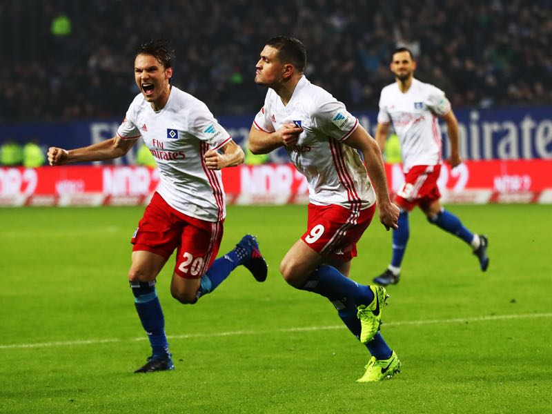 Kyriakos Papadopoulos of Hamburger SV celebrates scoring a goal with Albin Ekdal of Hamburger SV during the Bundesliga match between Hamburger SV and Bayer 04 Leverkusen at Volksparkstadion on February 3, 2017 in Hamburg, Germany. (Photo by Martin Rose/Bongarts/Getty Images)