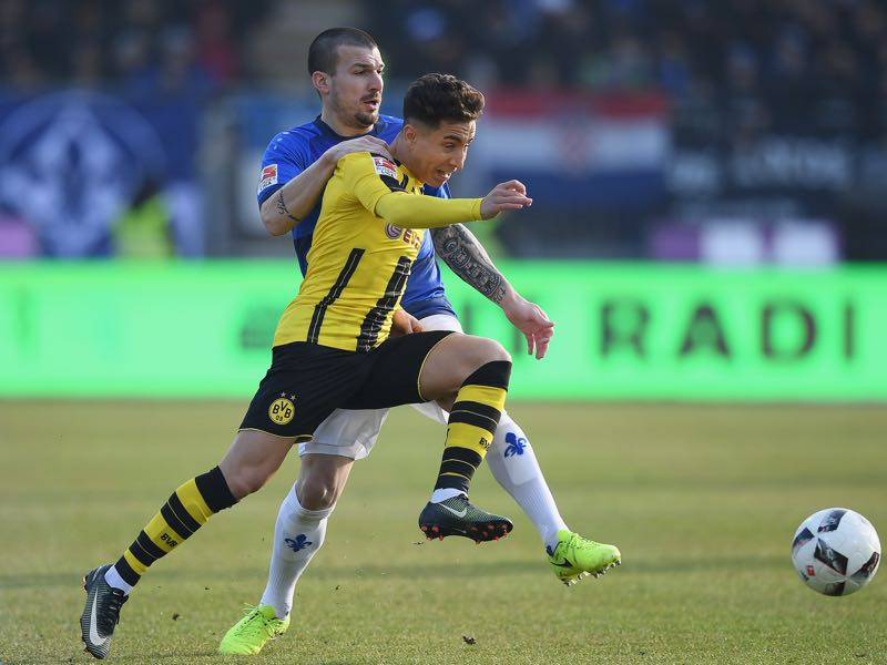 Emre Mor of Dortmund is challenged by Jerome Gondorf of Darmstadt during the Bundesliga match between SV Darmstadt 98 and Borussia Dortmund at Stadion am Boellenfalltor on February 11, 2017 in Darmstadt, Germany. (Photo by Matthias Hangst/Bongarts/Getty Images)