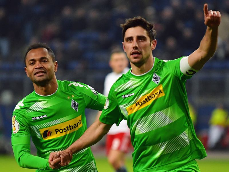Lars Stindl (R) celebrates a goal with his teammate Raffael. (Photo by Stuart Franklin/Bongarts/Getty Images)