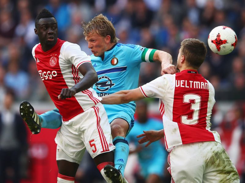 Davinson Sanchez and Joel Veltman of Ajax battles for the ball with Dirk Kuyt of Feyenoord Rotterdam during the Dutch Eredivisie match between Ajax Amsterdam and Feyenoord. (Photo by Dean Mouhtaropoulos/Getty Images)