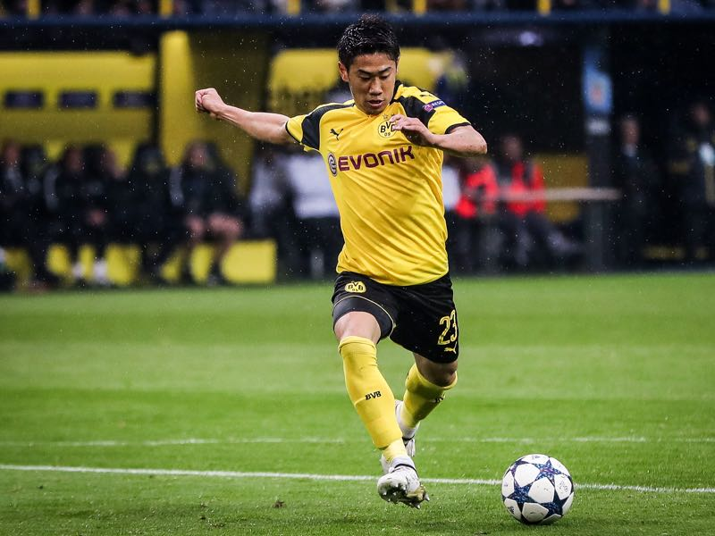 Shinji Kagawa is one of many Japanese players, who had success playing in Germany. (Photo by Maja Hitij/Bongarts/Getty Images)