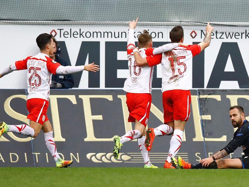 Marc Grüttner (r) celebrates one of his 13 goals he scored this season. (Photo by Joachim Sielski/Bongarts/Getty Images)