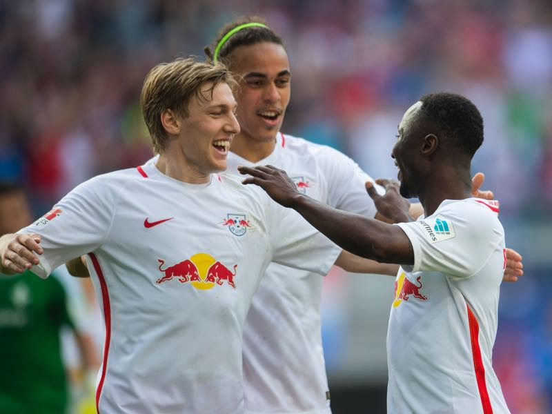 Leipzig's management have already told stars Forsberg (l), Poulson (c) and Keïta (r) that they will not be allowed to leave the club. (ROBERT MICHAEL/AFP/Getty Images)