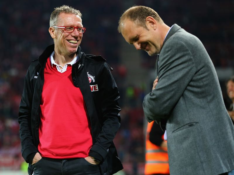 For the last four years Peter Stöger (l.) and Jörg Schmadtke (r.) were the faces of success in Köln. (Photo by Alex Grimm/Bongarts/Getty Images)