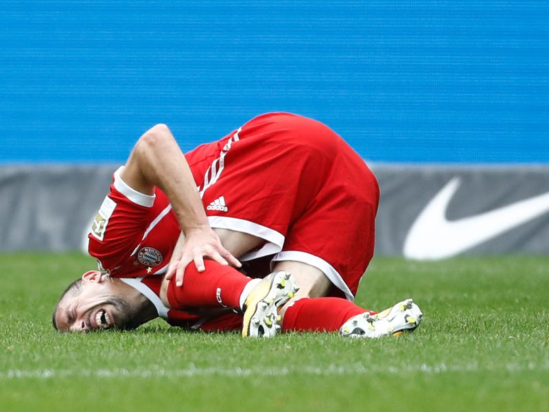 Frank Ribéry holds his left knee just moments after hyperextending the joint. (ODD ANDERSEN/AFP/Getty Images)