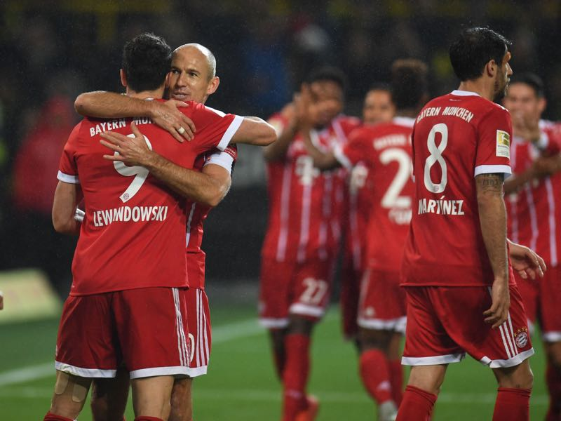 Bayern celebrate their third goal against Dortmund. (PATRIK STOLLARZ/AFP/Getty Images)