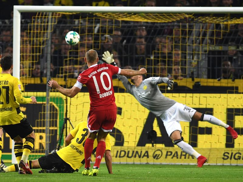 BVB v Bayern - Arjen Robben makes it 1-0 with a wonderfully curled finish. (PATRIK STOLLARZ/AFP/Getty Images)