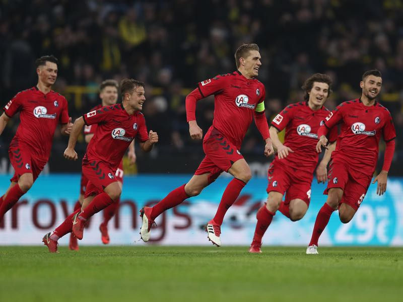 Borussia Dortmund vs SC Freiburg - Nils Petersen (c.) is celebrating one of his two goals. (Photo by Lars Baron/Bongarts/Getty Images)