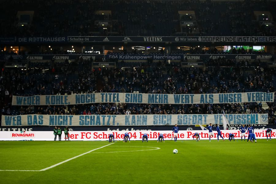 "Schalke fans react to Goretzka leaving the club by holding up a banner that read: ""No money, nor titles are worth more than our club. Those who don't value that should piss off."" (Photo by Maja Hitij/Bongarts/Getty Images)"