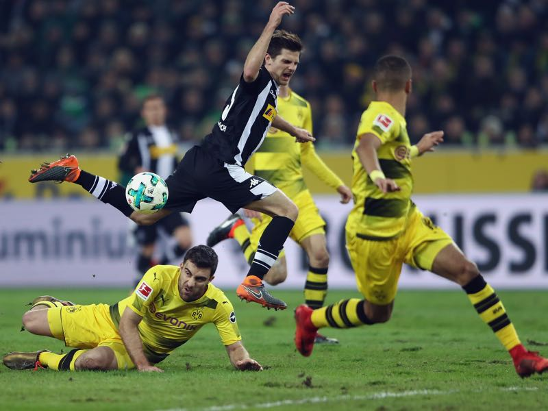 Gladbach vs Dortmund - Both sides have plenty of technical skills, but the pitch conditions meant that it became a football battle rather than a football fest. (Photo by Alex Grimm/Bongarts/Getty Images)