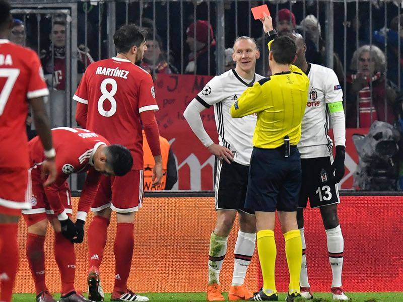 Besiktas defender Domagoj Vida was rightfully sent off in the first half. (THOMAS KIENZLE/AFP/Getty Images)