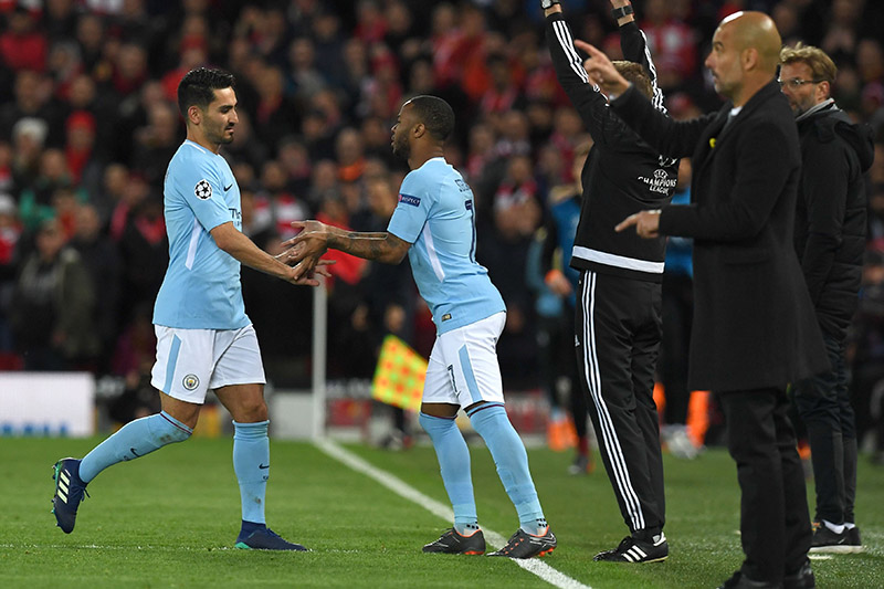 Manchester City's German midfielder Ilkay Gundogan (L) is substituted by Manchester City's English midfielder Raheem Sterling during the UEFA Champions League first leg quarter-final football match between Liverpool and Manchester City, at Anfield stadium in Liverpool, north west England on April 4, 2018. / AFP PHOTO / Paul ELLIS (Photo credit should read PAUL ELLIS/AFP/Getty Images)