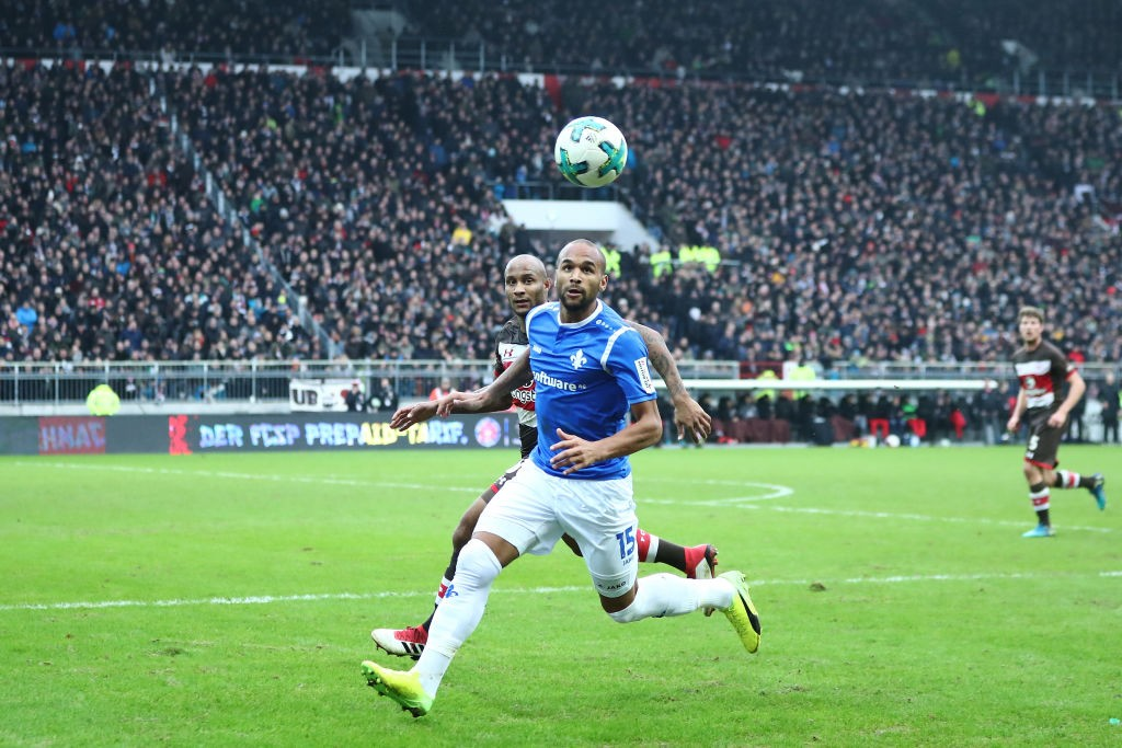 Christopher Avevor (L) of Pauli and Terrence Boyd (R) of Darmstadt compete for the ball during the Second Bundesliga match between FC St. Pauli and SV Darmstadt 98 at Millerntor Stadium on January 28, 2018 in Hamburg, Germany. (Photo by Oliver Hardt/Bongarts/Getty Images)