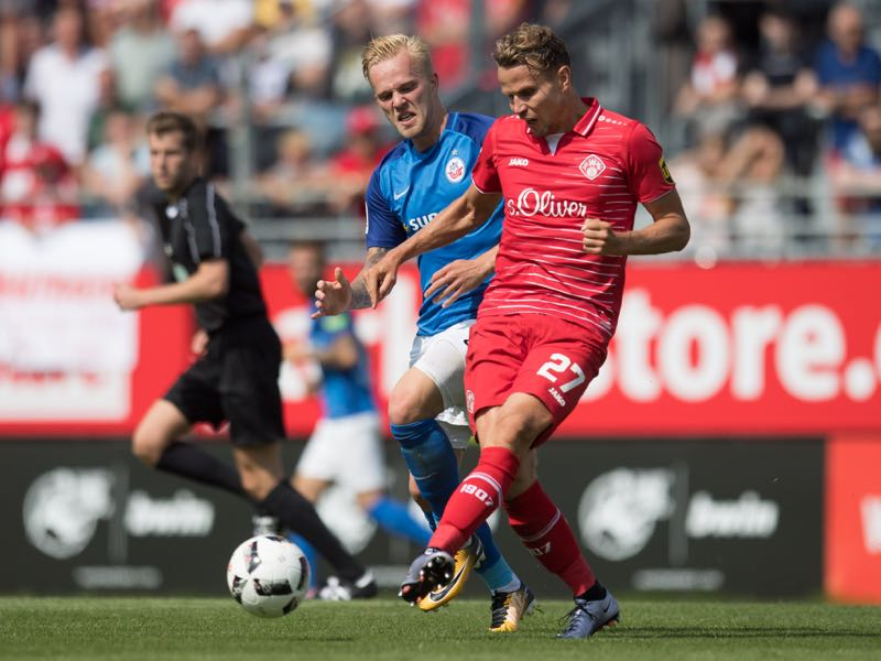 Sebastian Schuppan of Wuerzburg (R) is challenged by Marcel Hilssner of Rostock during the 3. Liga match between FC Wuerzburger Kickers and F.C. Hansa Rostock at Flyeralarm-Arena on August 20, 2017 in Wuerzburg, Germany. (Photo by Daniel Kopatsch/Bongarts/Getty Images)