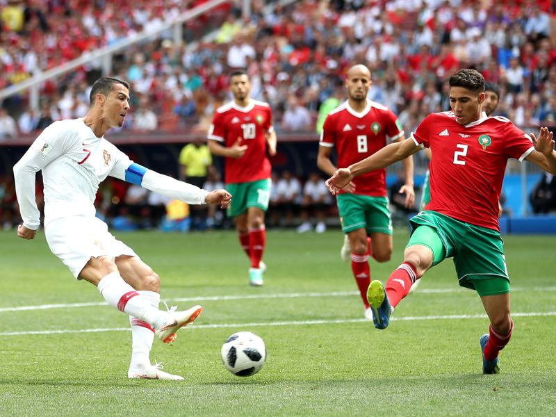 Cristiano Ronaldo of Portugal is challenged by Bruno Alves of Portugal during the 2018 FIFA World Cup Russia group B match between Portugal and Morocco at Luzhniki Stadium on June 20, 2018 in Moscow, Russia. (Photo by Michael Steele/Getty Images)