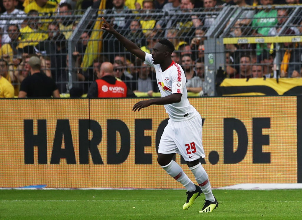 Jean-Kevin Augustin of RB Leipzig celebrates as he scores his team's first goal during the Bundesliga match between Borussia Dortmund and RB Leipzig at Signal Iduna Park on August 26, 2018 in Dortmund, Germany. (Photo by Maja Hitij/Bongarts/Getty Images)