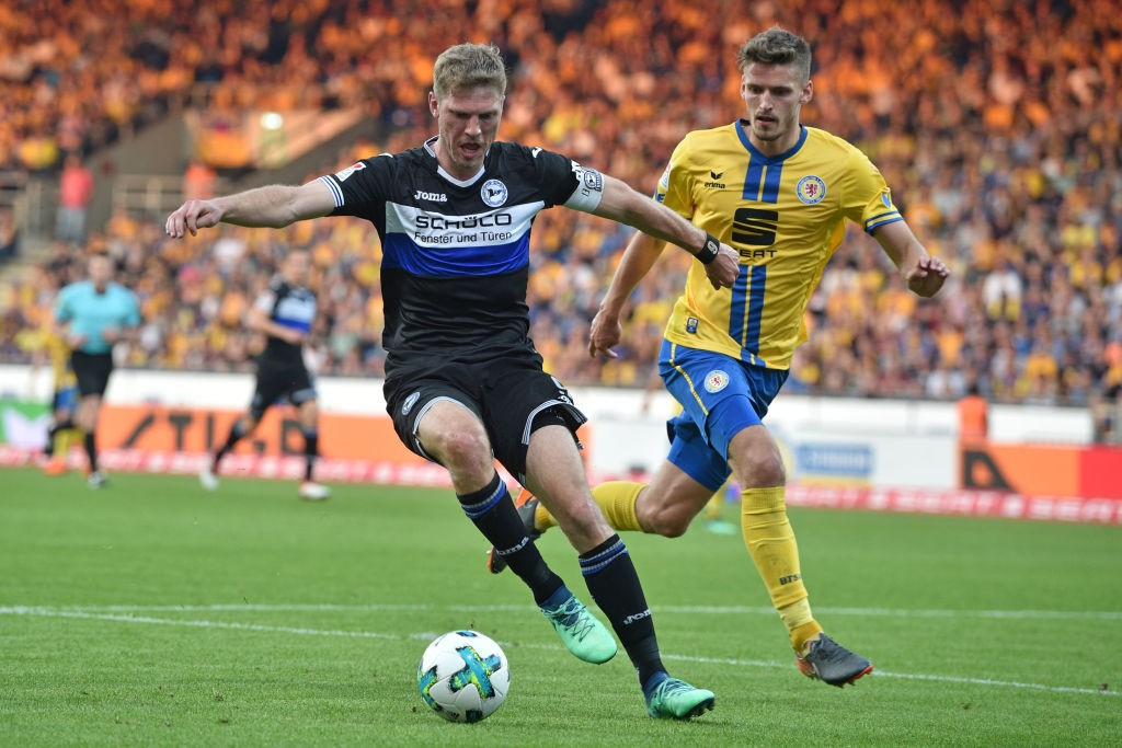 Fabian Klos (L) of Bielefeld and Gustav Valsvik of Braunschweig fight for the ball during the Second Bundesliga match between Eintracht Braunschweig and DSC Arminia Bielefeld at Eintracht Stadion on April 20, 2018 in Braunschweig, Germany. (Photo by Thomas Starke/Bongarts/Getty Images)