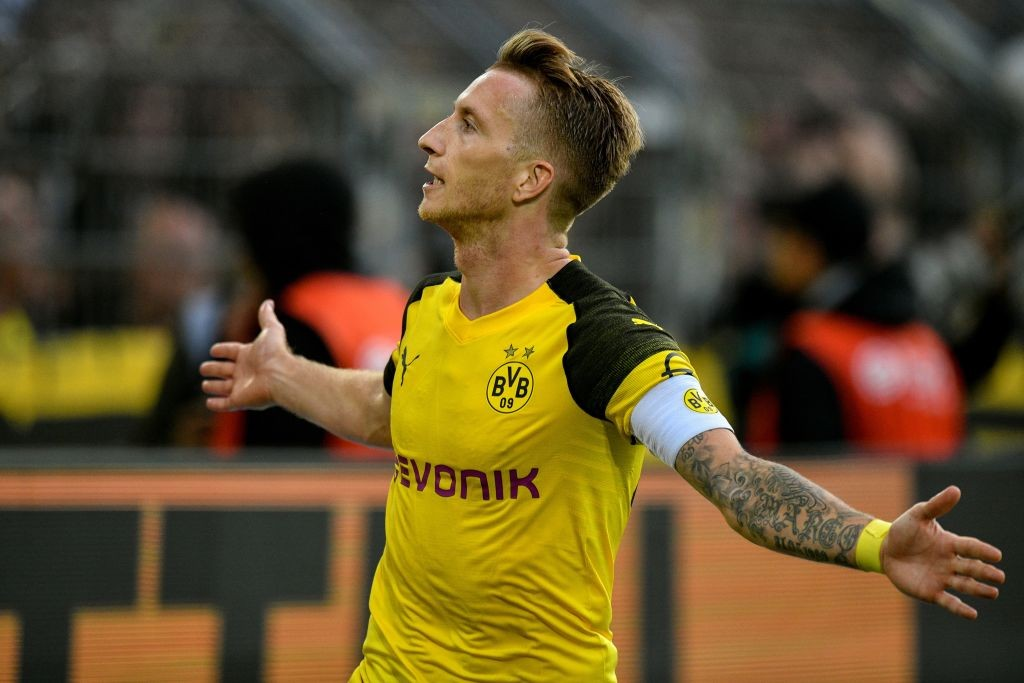 Dortmund's forward Marco Reus celebrates after he scored the team's fourth goal during the German first division Bundesliga football match Borussia Dortmund v RB Leipzig in Dortmund, western Germany, on August 26, 2018. (Photo by SASCHA SCHUERMANN / AFP) / RESTRICTIONS: DFL REGULATIONS PROHIBIT ANY USE OF PHOTOGRAPHS AS IMAGE SEQUENCES AND/OR QUASI-VIDEO (Photo credit should read SASCHA SCHUERMANN/AFP/Getty Images)