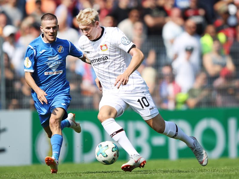 Julian Brandt of Bayer Leverkusen is tackled by Kreshnik Lushtaku of 1. CfR Pforzheim during the DFB Cup match between 1. CfR Pforzheim and Bayer Leverkusen on August 18, 2018 in Pforzheim, Germany. (Photo by Adam Pretty/Bongarts/Getty Images)