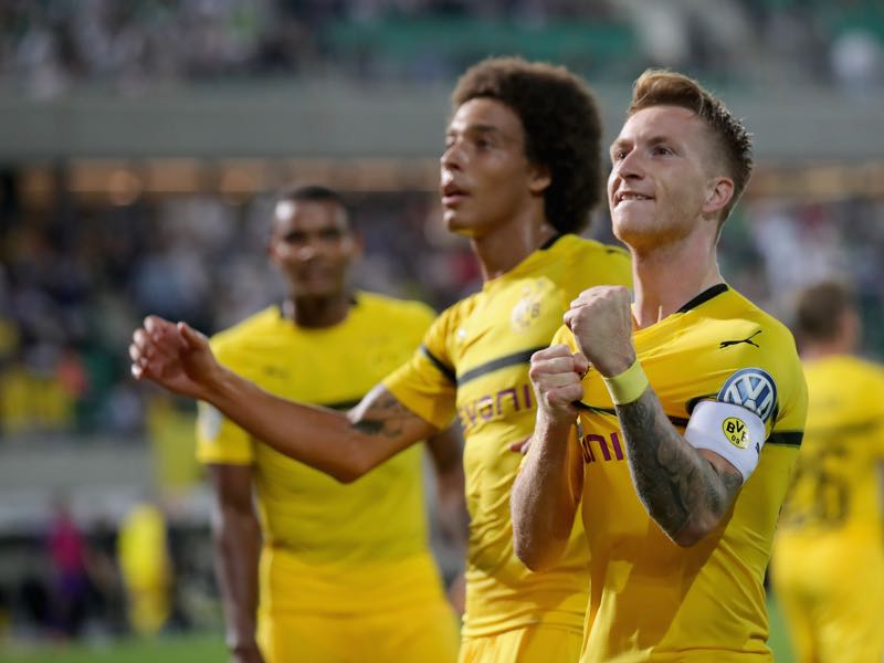 New signing Axel Witsel (l) and captain Marco Reus (r) are expected to lead Borussia Dortmund this upcoming season (Photo by Alexander Hassenstein/Bongarts/Getty Images)