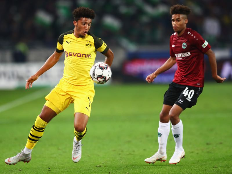 Hannover v Borussia Dortmund - Linton Maina (r.) was the man of the match (Photo by Martin Rose/Bongarts/Getty Images)
