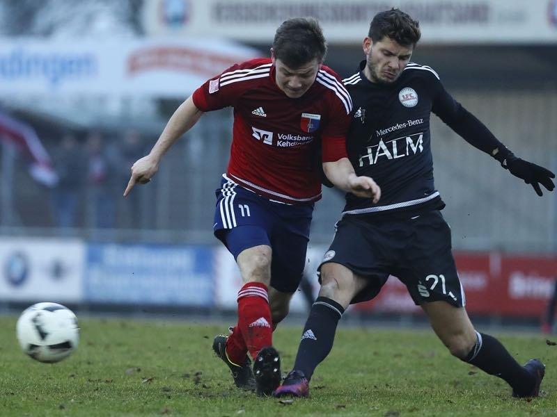 Jasper Goossen (L) of Drochtersen and Marco Schikora (R) of Egetorf competes for the ball during the Regionalliga Nord match SV Drochtersen Assel and 1. FC Germania Egetorf Langreder at the Kehdinger Stadion on February 5, 2017 in Drochtersen, Germany.on February 5, 2017 in Drochtersen, Germany. (Photo by Oliver Hardt/Bongarts/Getty Images)