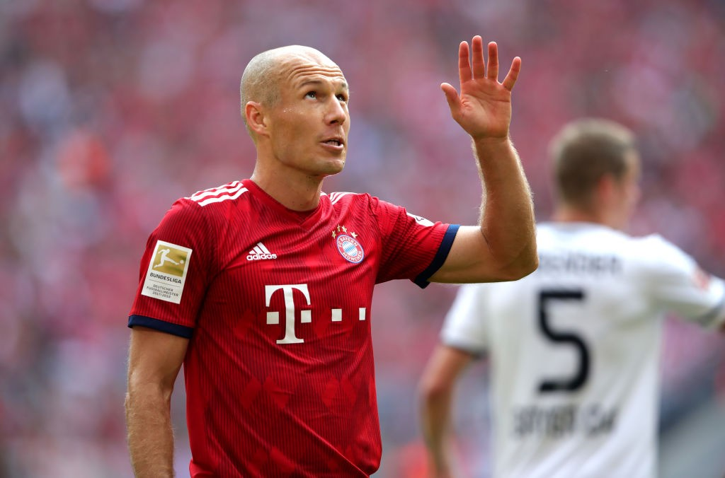 Arjen Robben apologies to the Bayern fans behind the goal for missing a trade mark shot - Bayern vs Bayer