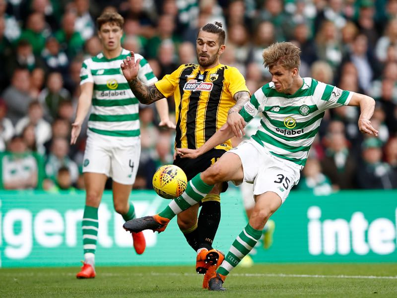 Marko Livaja of AEK Athens (L) and Kristoffer Ajer of Celtic compete for the ball during the UEFA Champions League Qualifier between Celtic and AEK Athens at Celtic Park Stadium on August 8, 2018 in Glasgow, Scotland. (Photo by Julian Finney/Getty Images)