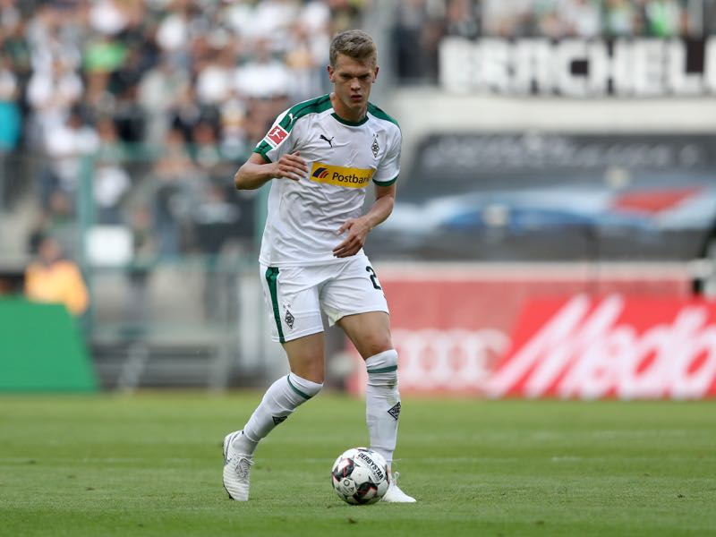 Matthias Ginter of Moenchengladbach runs with the ball during the Bundesliga match between Borussia Moenchengladbach and Bayer 04 Leverkusen at Borussia-Park on August 25, 2018 in Moenchengladbach, Germany. The match between Gladbach and Leverkusen ended 2-0. (Photo by Christof Koepsel/Bongarts/Getty Images)