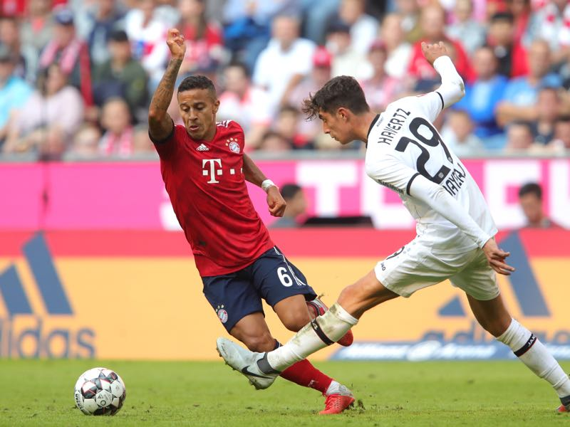 Bayern v Bayer Leverkusen - Thiago Alcantara of Bayern Munich (L) challenges for the ball with Kai Havertz of Bayer 04 Leverkusen during the Bundesliga match between FC Bayern Muenchen and Bayer 04 Leverkusen at Allianz Arena on September 15, 2018 in Munich, Germany. (Photo by Alexander Hassenstein/Bongarts/Getty Images)