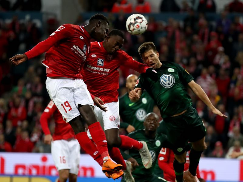Mainz vs Wolfsburg - Moussa Niakhate #19, Jean Philippe Mateta of Mainz and Ignacio Camacho of Wolfsburg head for the ball during the Bundesliga match between 1. FSV Mainz 05 and VfL Wolfsburg at Opel Arena on September 26, 2018 in Mainz, Germany. (Photo by Alex Grimm/Bongarts/Getty Images)