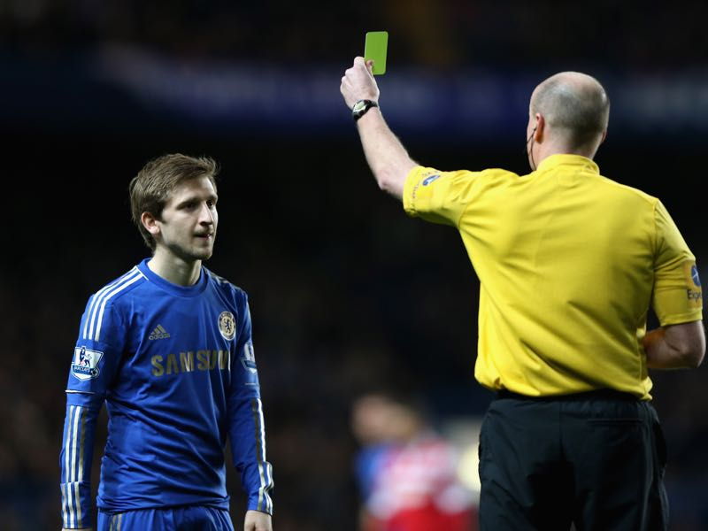 Marko Marin of Chelsea is shown a yellow card by referee Lee Mason after a strong tackle on Stephane Mbia of Queens Park Rangers during the Barclays Premier League match between Chelsea and Queens Park Rangers at Stamford Bridge on January 2, 2013 in London, England. (Photo by Ian Walton/Getty Images)