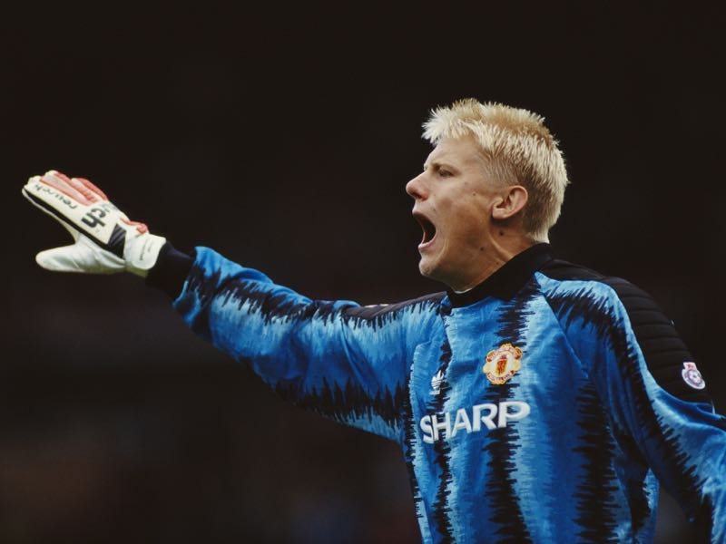 Manchester United goalkeeper Peter Schmeichel in action during a League Division One match between Manchester United and Liverpool at Old Trafford on October 5, 1991 in Manchester, England. (Photo by Ben Radford/Allsport UK/Getty Images)