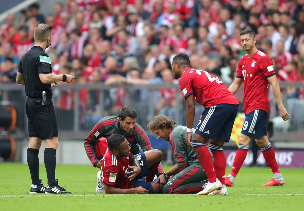 Corentin Tolisso goes down injured during the Bundesliga match Bayern vs Bayer