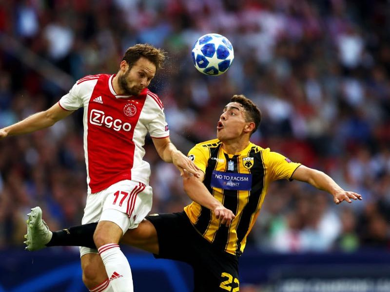 Daley Blind of Ajax wins a header over Ezequiel Ponce of AEK Athens during the Group E match of the UEFA Champions League between Ajax and AEK Athens at Johan Cruyff Arena on September 19, 2018, in Amsterdam, Netherlands. (Photo by Dean Mouhtaropoulos/Getty Images)
