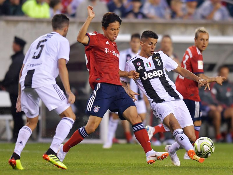 Joao Cancelo #20 of Juventus kicks the ball away from Jeong Woo-Yeong #30 of Bayern Munich during the International Champions Cup 2018 match between Juventus and FC Bayern Munich at Lincoln Financial Field on July 25, 2018 in Philadelphia, Pennsylvania. (Photo by Drew Hallowell/Getty Images)