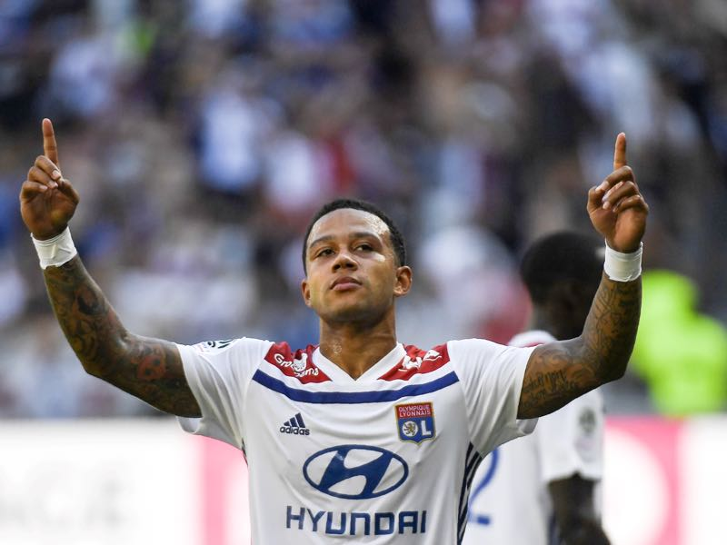 yon's Dutch forward Memphis Depay celebrates after scoring a goal during the French L1 football match between Lyon and Amiens on August 12 , 2018, in Decines-Charpieu near Lyon, central-eastern France. (Photo by PHILIPPE DESMAZES / AFP)