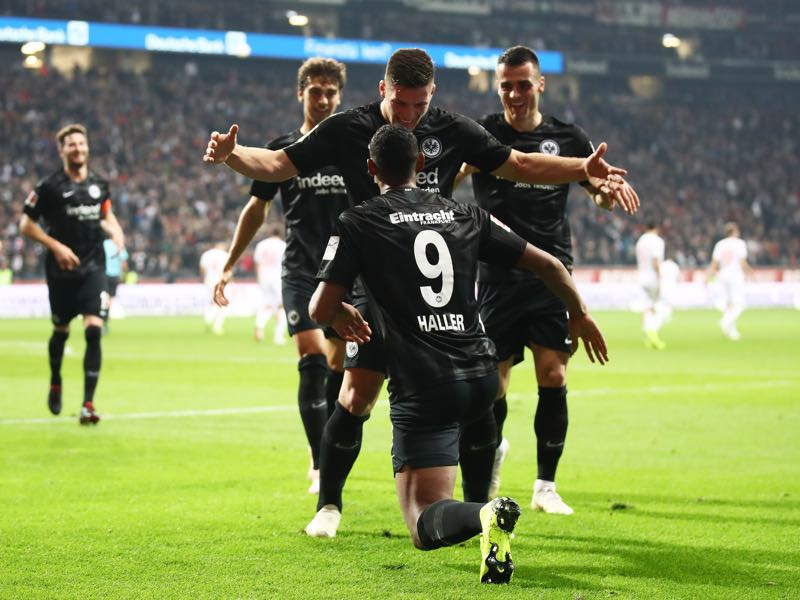 Luka Jovic of Eintracht Frankfurt celebrates after scoring his team's third goal with Sebastien Haller of Eintracht Frankfurt (9) during the Bundesliga match between Eintracht Frankfurt and Fortuna Duesseldorf at Commerzbank-Arena on October 19, 2018 in Frankfurt am Main, Germany. (Photo by Alex Grimm/Bongarts/Getty Images)