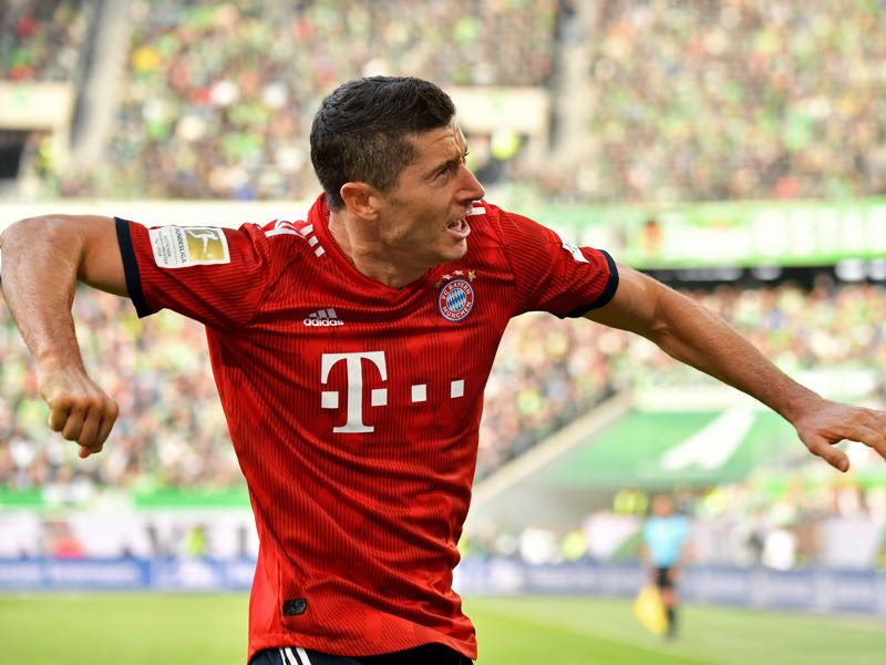 Wolfsburg v Bayern - Polish forward Robert Lewandowski celebrates scoring the opening goal during the German First division Bundesliga football match between VfL Wolfsburg and Bayern Munich, on October 20, 2018 in Wolfsburg. (Photo by John MACDOUGALL / AFP)