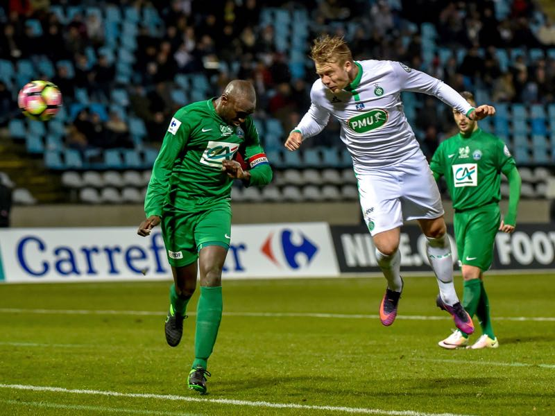 Saint-Etienne's Norwegian forward Alexander Söderlund (R) heads the ball to score a goal during the French Cup football match between Croix Football Iris Club (CFA) and AS Saint-Etienne (ASSE) from whom the Norwegian national team player joined Rosenborg ahead of the season (PHILIPPE HUGUEN/AFP/Getty Images)