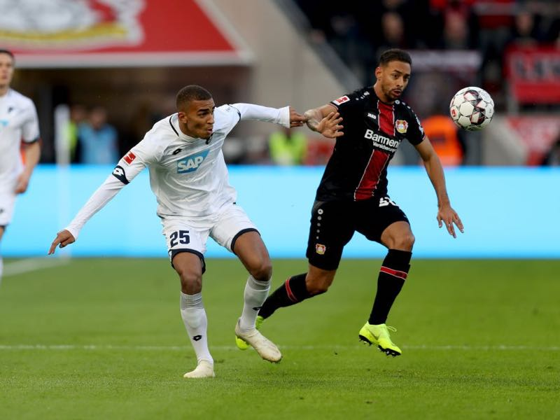 Bayer Leverkusen v Hoffenheim - Kevin Akpoguma of 1899 Hoffenheim is challenged by Karim Bellarabi of Bayer 04 Leverkusen during the Bundesliga match between Bayer 04 Leverkusen and TSG 1899 Hoffenheim at BayArena on November 3, 2018 in Leverkusen, Germany. (Photo by Maja Hitij/Bongarts/Getty Images)