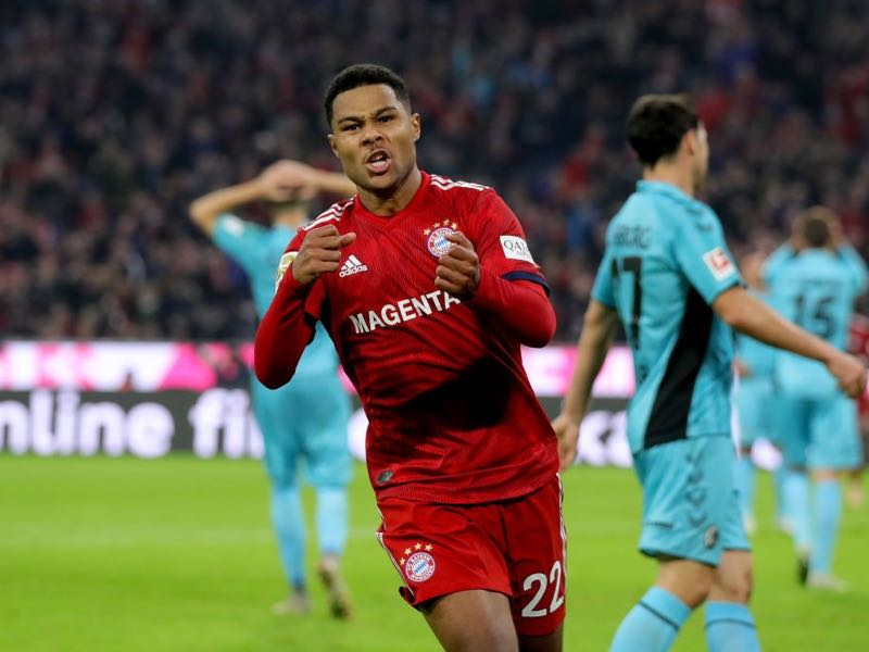 Serge Gnabry of Bayern Munich celebrates after scoring his team's first goal during the Bundesliga match between FC Bayern Muenchen and Sport-Club Freiburg at Allianz Arena on November 3, 2018 in Munich, Germany. (Photo by Alexander Hassenstein/Bongarts/Getty Images)