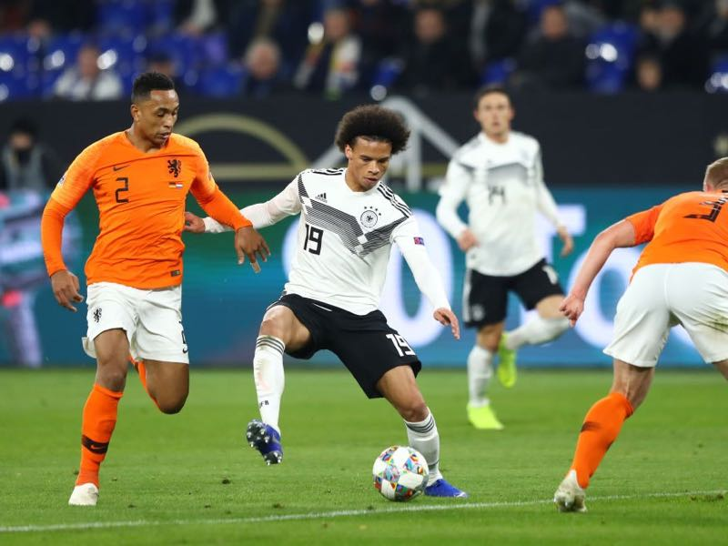 Germany v Netherlands - Leroy Sane of Germany battles for possession with Denzel Dumfries of the Netherlands during the UEFA Nations League A group one match between Germany and Netherlands at Veltins-Arena on November 19, 2018 in Gelsenkirchen, Germany. (Photo by Martin Rose/Bongarts/Getty Images)